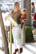 http://img223.imagevenue.com/loc1031/th_179514024_Hilary_Duff_out_in_Beverly_Hills7_122_1031lo.jpg