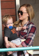 http://img223.imagevenue.com/loc1098/th_027285803_Hilary_Duff_Babies_First_Class3_122_1098lo.jpg